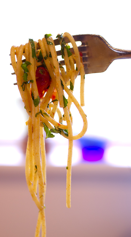 Pasta with grape tomatoes, colatura and garlic