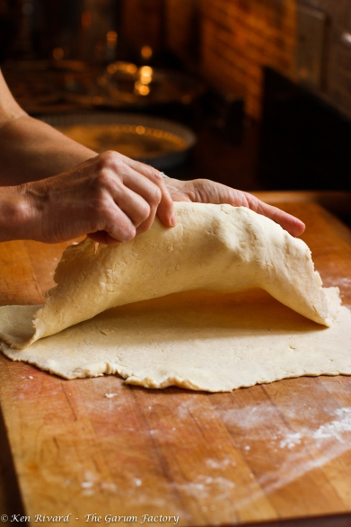 Fold the rolled dough into quarters.